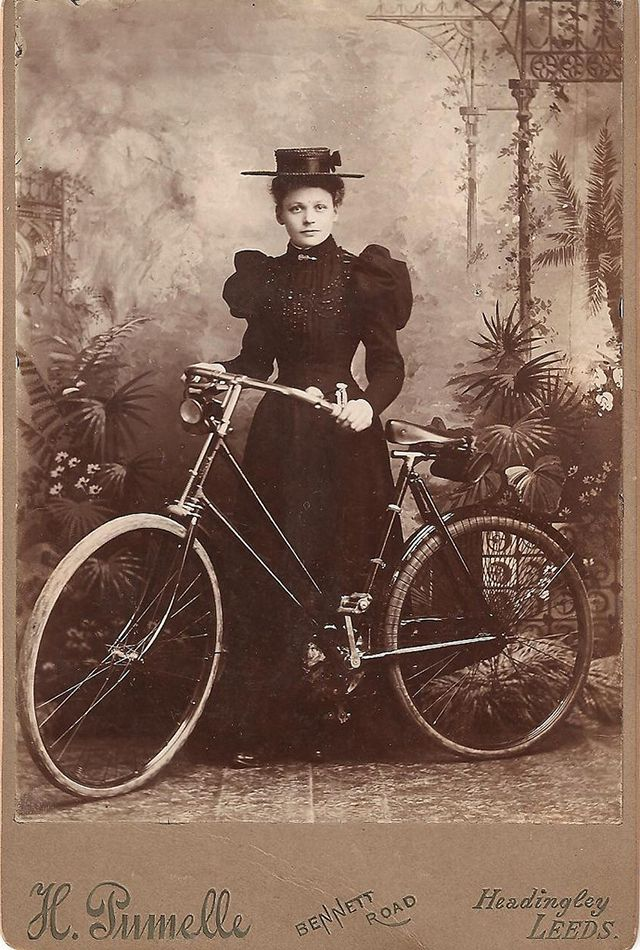 I love her direct gaze.  Vintage Everyday: 40 Interesting Vintage Photos of Women Posing With Bicycles