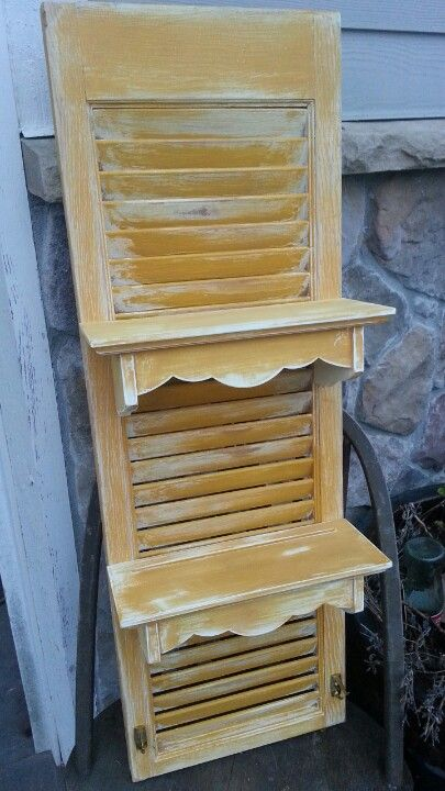 Add existing small wooden shelves to a salvaged shutter.  Upcycle, repurpose, recycle!  For ideas and goods shop at Estate ReSale  ReDesign in Bonita Springs, FL