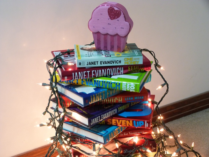 A book tree made out of Janet Evanovich books. With a cupcake topper- b/c I'm Team Cupcake.