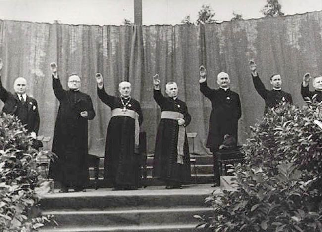 Priests giving the Hitler salute at a Catholic youth rally in the Berlin-Neukölln stadium in August 1933.Priests giving the Hitler salute