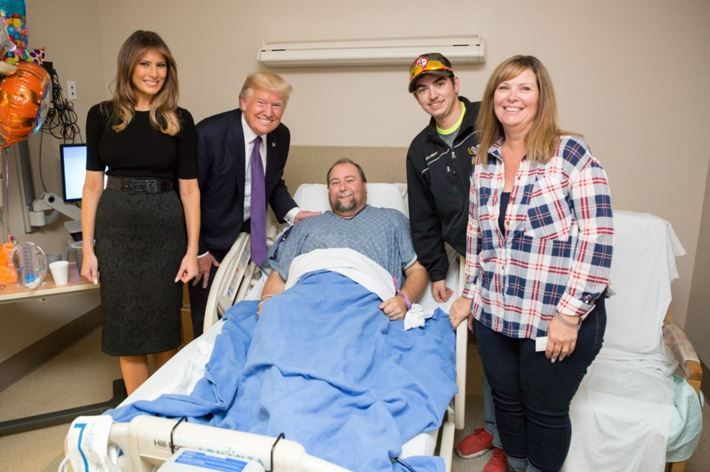 President Donald J. Trump and First Lady Melania Trump visit with patient Clint Burton of Gillette, Wyoming, and members of his family, Wednesday, October 4, 2017, at the University Medical Center of Southern Nevada, who was injured in the mass shooting, Sunday, October 1, 2017, in Las Vegas, Nevada.