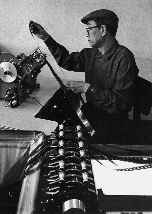 Director Akira Kurosawa cutting one of his films.