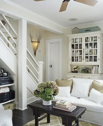 #basement #light colors #neutral #white #airy #under stairs storage