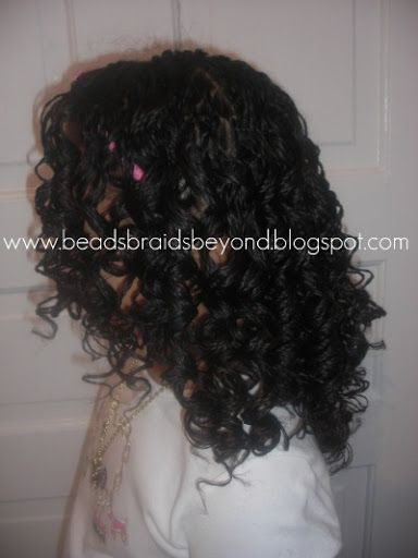 Mini twists curled with curlformers. To learn how to grow your hair longer click here - http://blackhair.cc/1jSY2ux