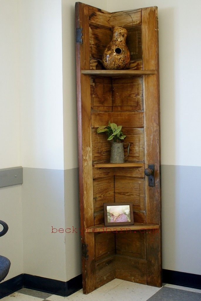 A corner shelf made from a vintage door for sale at the Main Street Industries wood shop!  Love!