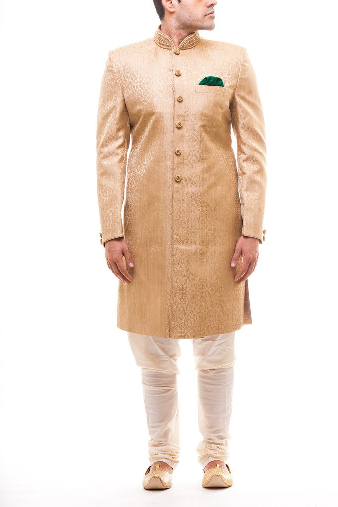 Gold tanchui brocade achkan with swarovski embroidered buttons and collar. Paired with plain a white churidar pajami, this look is perfect for the simple groom. Stole sold separately.