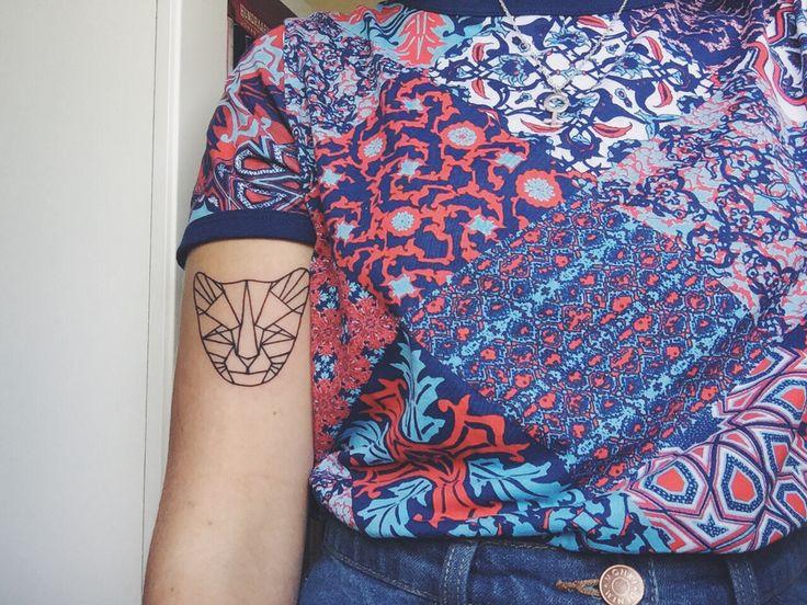 geometric cat tattoo.