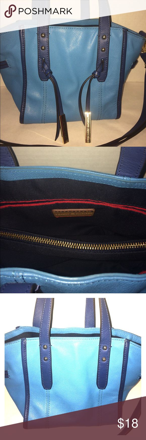 Blue Tommy Hilfiger handbag This blue handbag has two open compartments and a middle zipping compartment. It also has an inside zipping pocket and two open pockets perfect for cellphones and accessories! Tommy Hilfiger Bags Shoulder Bags