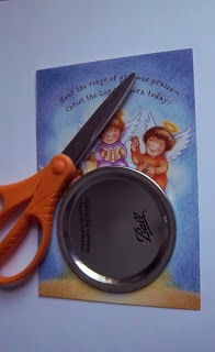 Cut out card to fit used canning lid. Hot glue magnet to back of canning lid. Cu...