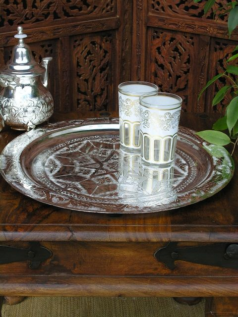 Silver accessories reflecting the light with dark wood furniture Create this look at home http://www.maroque.co.uk/showitem.aspx?id=ENT00421&p=00450&n=all
