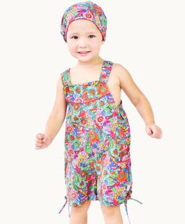 Super cute and practical! This Summer Bouquet print cotton playsuit is perfect for the little girl on the run. Pretty colourful flowers, sweet little bows and delicate lace trim add a charming touch!    Contrast tie on hem Patch pockets 100% #cotton #fairtrade #eternalcreation #ethical