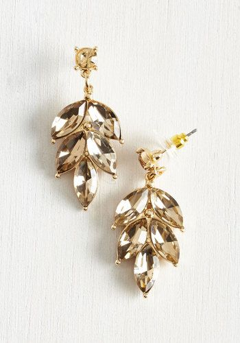 Greet guests at the launch party with a sparkling smile and these glistening earrings! A gold post pair displaying dangling leaves in a champagne hue, these dressy accessories aid you in expressing your excitement over this latest issue.