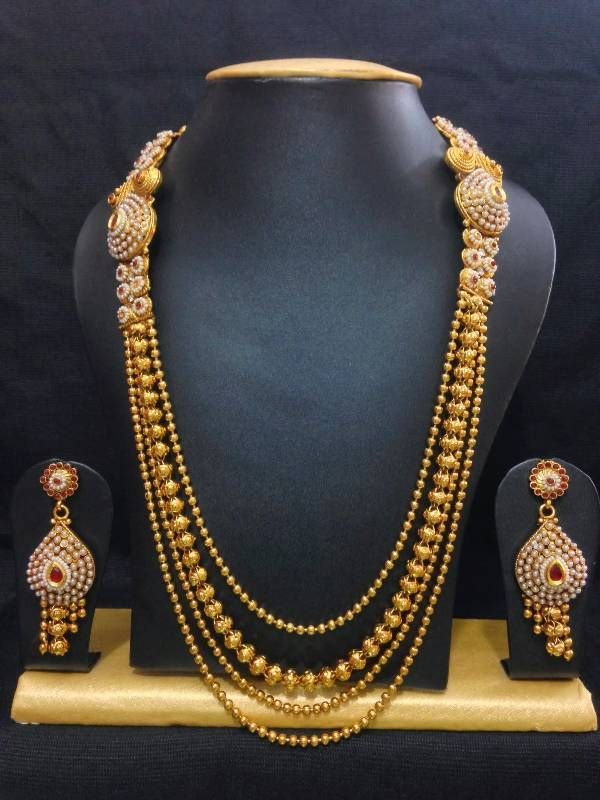 Traditional haram jewelry set in high gold polish with red stones