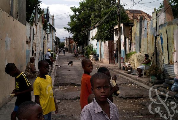 Kingston Jamaica Ghetto | Jamaican boys play along one of Kingston's inner-city ghetto streets ...