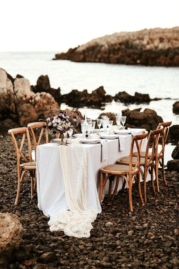 neutral organic beach table - http://ruffledblog.com/french-seaside-wedding-inspiration photo Pinewood Weddings