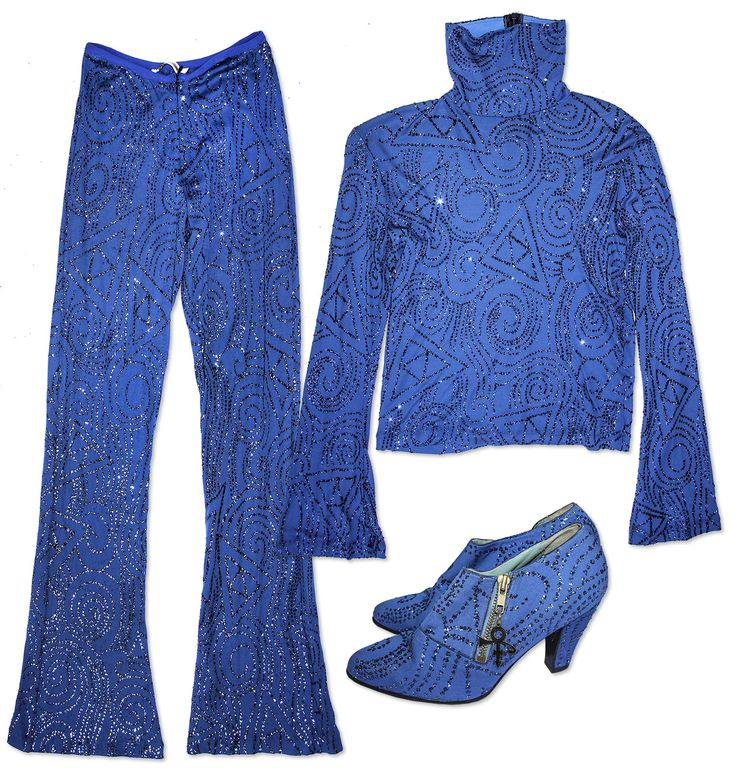 Prince worn blue ensemble. Custom-made stage costume features matching shirt, pants and shoes, al