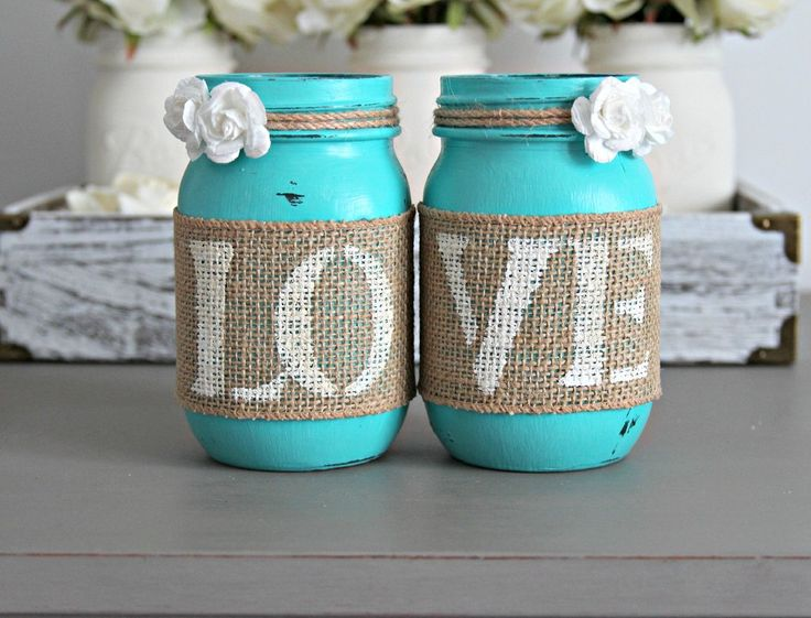 Two decorative Mason Jars in Turquoise  . Each jar is hand painted & distressed, decorated with natural burlap with old...