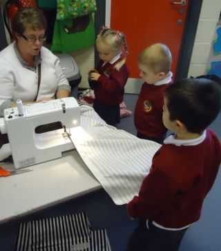 children are fascinated by a sewing machine #abcdoes #eyfs #earlyyearseducation