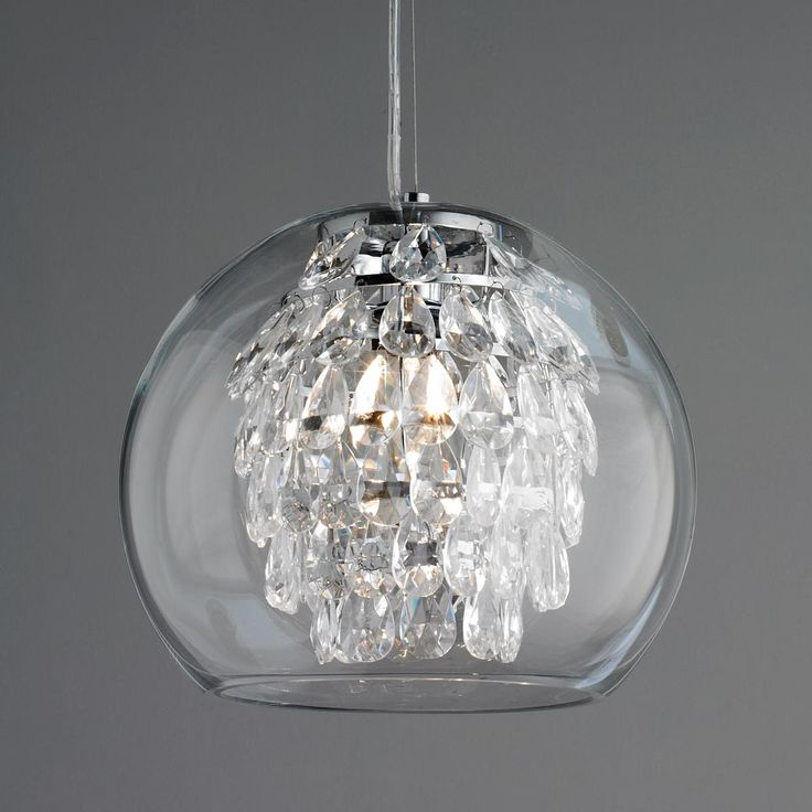 Glass Globe & Crystal Pendant Light Elegant and sophisticated, with a modern look for today's interiors, this unique pendant light glimmers with tiers of crystal pendalogues inside a clear glass globe. A smart look, with easy cleaning!
