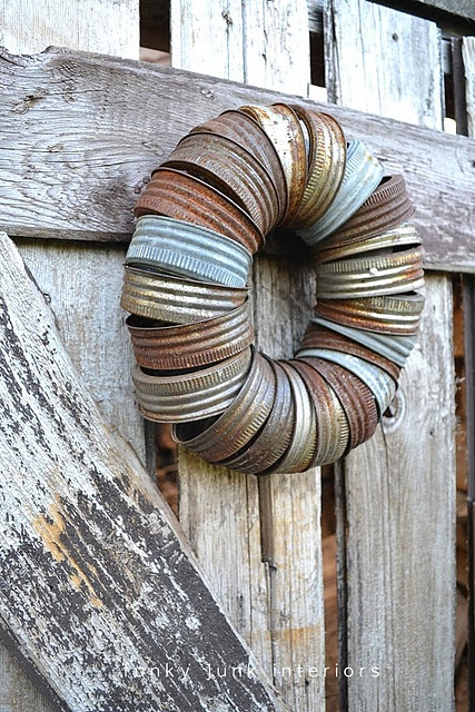 :canning jar lids, strung loosely on a fabric strip, then hung outdoors to rust. Lovely, old, easy... sort of like me.  BWAHahahahahaha!!!