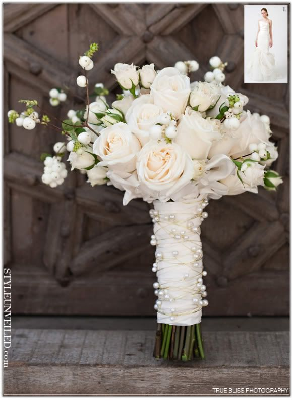What a lovely bouquet!! White roses and spray roses, with white berries, wrapped with pearls and ribbon. so sweet!