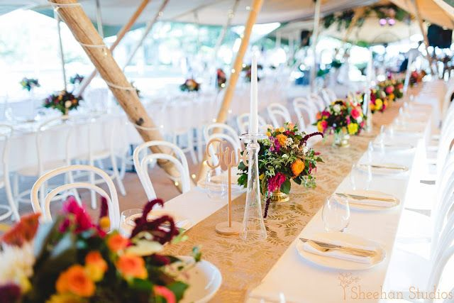 Bohemian | Wedding | table setting | Bright colours | trailing foliage | table centrepiece | Candle holders | Gold | Laser cut table numbers | Naomi Rose Floral Design | tipi wedding | Sheehan Studios photography