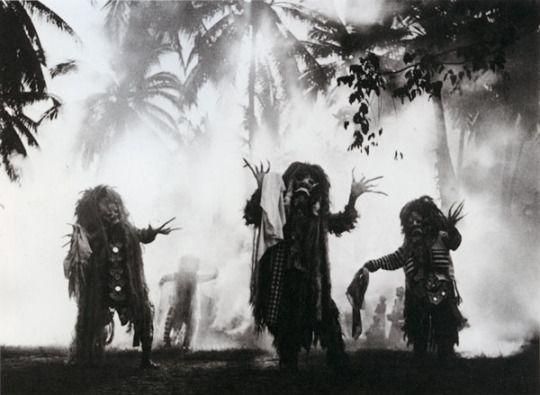 Ritual dancers wearing masks resembling Rangda, a malignant demon queen, from the Barong play at Pagoetan, Bali. Photo by Walter Spies, 1937