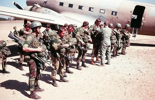 Rhodesian Soldiers getting ready for an airborne jump into Zambia on the border