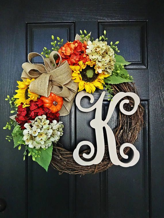 The Felicity Fall Wreath is a perfectly understated Wreath that is perfect to use from September through Thanksgiving. It is decorated with just the right mix of all the warm fall colors of orange, yellow, beige, green and red in lovely hydrangeas, pumpkin, sunflowers, burlap and greenery. Measuring 20 in diameter and built on an 18 grapevine wreath, the size is perfect for most standard doors. Choose to personalize by way of monogram via the pull down menu or order without.