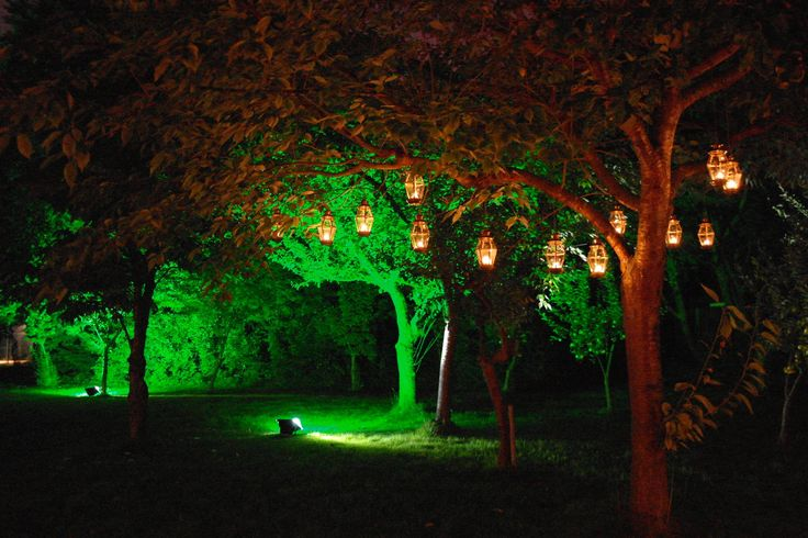 Brass lanterns on chains hung from tree by www.stressfreehire.com #venuetransformers