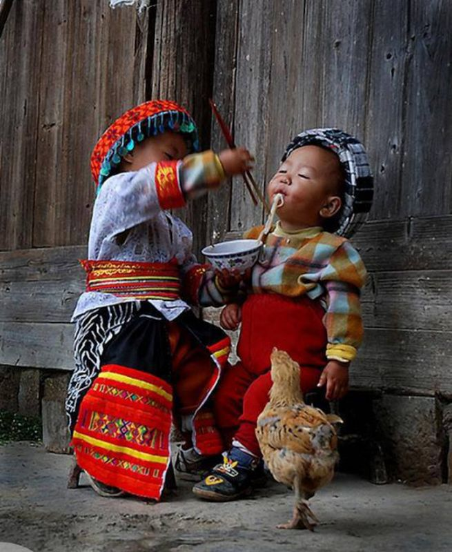 Children of Ha Giang Province, Vietnam. IS that a  chicken?