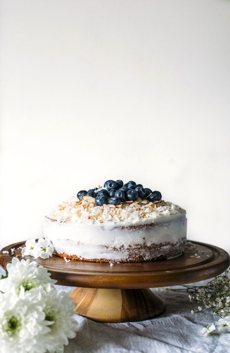 Vegan Coconut Cake | Moist cake made with coconut milk and coconut oil and topped with toasted shredded coconut | thealmondeater.com | #vegan