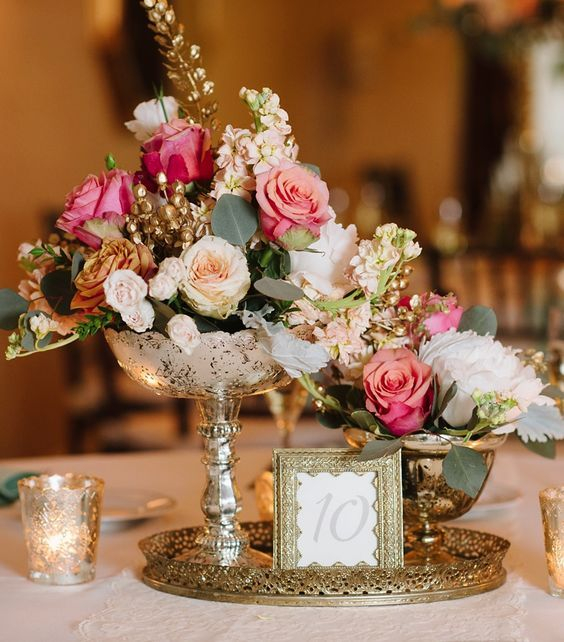 Featured Photographer: Natalie Franke Photography; Beautiful gold decor wedding reception centerpiece