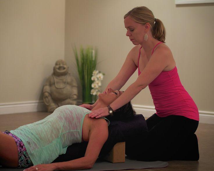 Hot stone restorative yoga at Pura Vida Soul Institute Inc.
