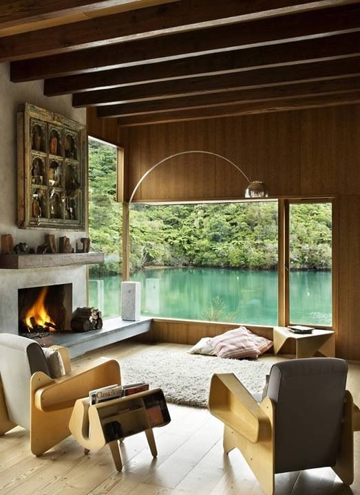 Love the window and luxurious lounging rug and pillows in front of fire place. Good solution to hard wood floor home, with desire for cozy floor space.--- Waterfall Bay House by Bossley Architects. HomeDSGN