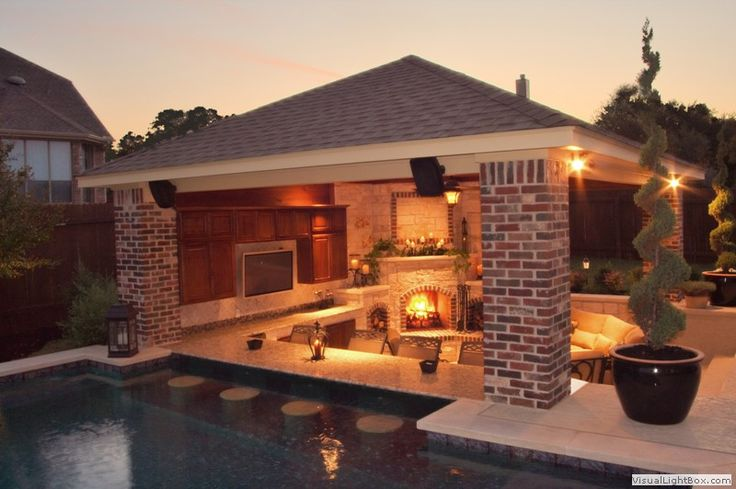 pool with bar and kitchen