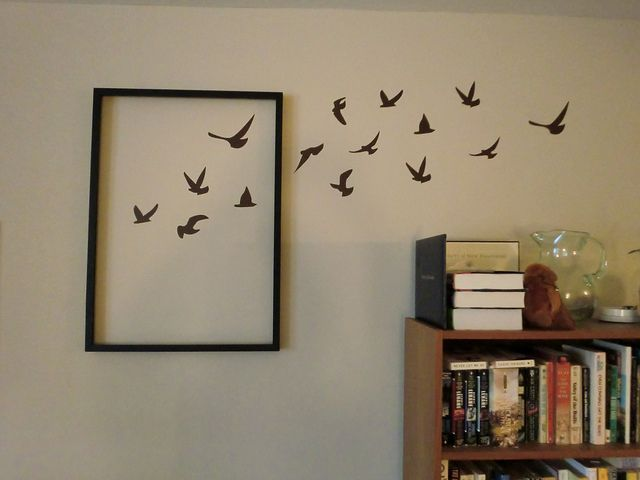 """""""Outside the box"""" wall decor - love this idea, but I would probably have them flying out form the frame."""