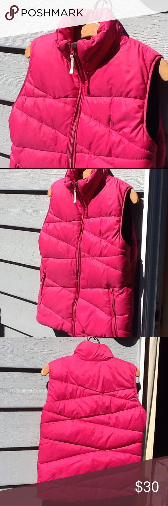 Helly Hansen puffer vest Gorgeous! The fabric content is missing, but it feels like down and feather interior. Used condition with normal wear. Helly Hansen Jackets & Coats Vests