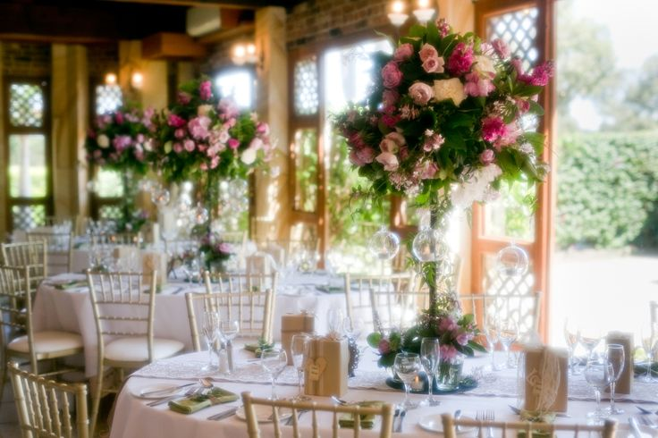 The garden room looking dreamy with beautiful flowers and candles | garden wedding and beautiful wedding centre pieces | Eschol Park House Real Wedding | by The Moments Photography