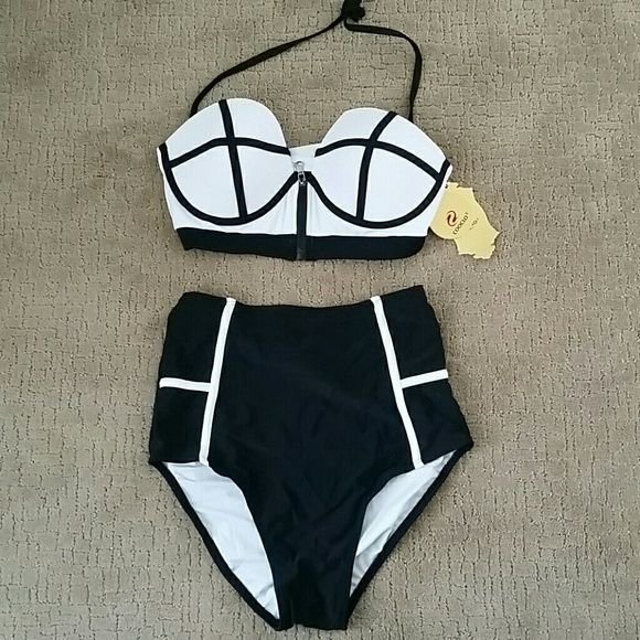 Black and white high waisted swimsuit Very trendy, high waisted two piece.  Looks very cute on.  Size Medium fits about a 8-10. Swim Bikinis