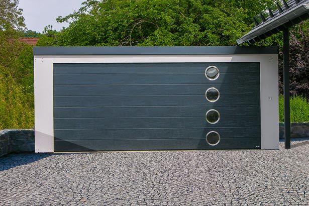 MyPort Doppelgarage mit individuellem Sektionaltor. #Garage #Fertiggarage #Stahlgarage # Metallgarage #Doppelgarage #Einzelgarage #Wohnmobil #Caravan #Wohnwagen #Auto #Fahrrad #design #architecture #architektur #myport