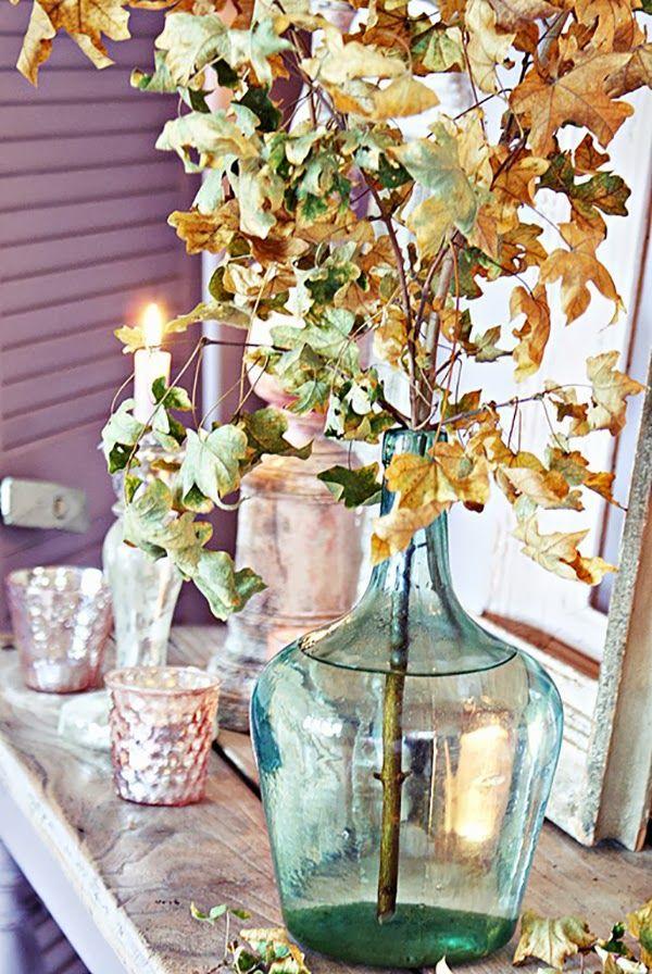 Lovely autumnal leaves in big bottle vase