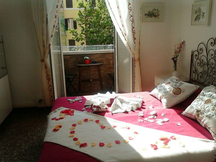 Red romantic apartment rome balcony bedroom petals roses towel pillows flowers info@moustachehouse.it