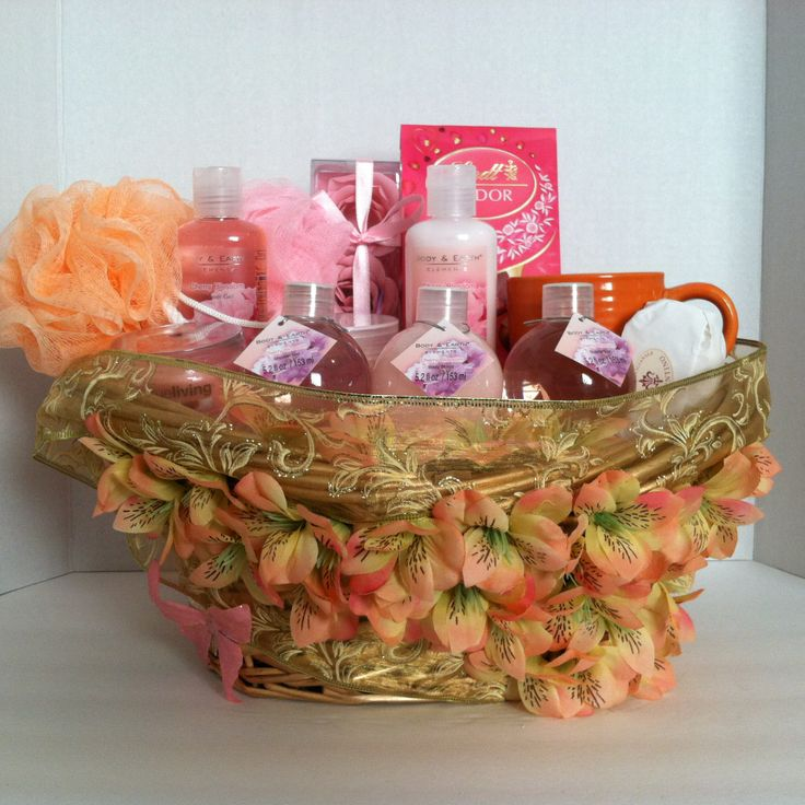 (Spa Gift Basket) Pamper that special someone with our luxurious and relaxing bath and body gift baskets.  (2) Shower Gel   Body Lotion   Body Scrub   Bubble Bath   Bath Salt  (2) Body Sponge   Cleansing Bar   Cup   Soap Rose Petals   Lindt Lindor Irresistibly Smooth Milk And White Milk Chocolate Truffles
