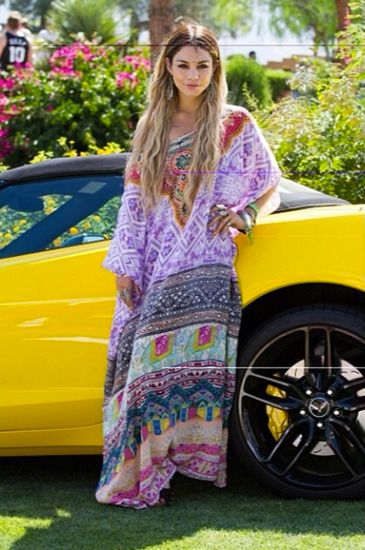 Hudgens goes all-out for Coachella: the star channeled her inner bohemian goddess in a flowy kaftan. Mermaid-inspired tresses completed the ethereal look. Read more at http://la-confidential-magazine.com/the-latest/style-and-beauty/postings/celebrity-trends-at-coachella#Z4JOXcekljXHPJbF.99