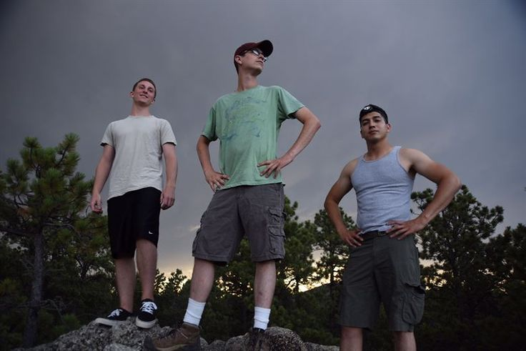 28th Comptroller Squadron members, from left, Air Force Airman 1st Class Matt Hinson, a financial customer service technician, Air Force Staff Sgt. William Johnson, unit deployment manager, and Air Force Airman 1st Class Fabian Miranda-Corpuz, a budget analyst, pose after conquering the climb to the top of a rock formation at Custer State Park, S.D., July 24, 2015. Hiking is one way Hinson and his co-workers relax and bond outside of work. U.S. Air Force photo by Airman 1st Class James L…