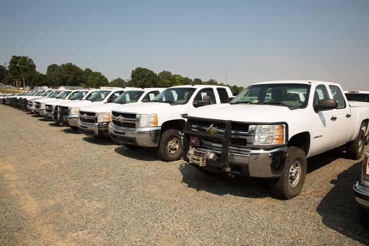 A portion of our fleet of used GMC, Ford, Dodge, and Chevy work trucks at public auction. You set the price, no minimums, no reserves.
