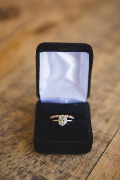 Solitaire oval-cut diamond engagement ring with thin yellow gold band {Emily and Daniel LLC}