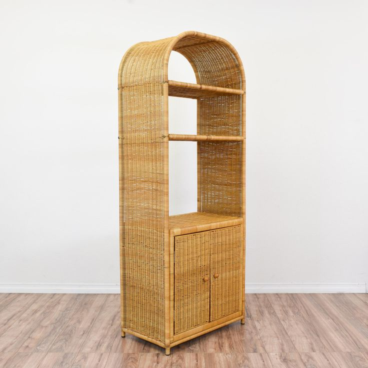 This tropical bookcase is featured in a woven wicker with a light blonde finish. This display shelf is in great condition with an interior cabinet, curved top and 2 shelves. Beach chic bookshelf perfect for displaying books and knick knacks! #tropical #storage #bookcase&shelving #sandiegovintage #vintagefurniture
