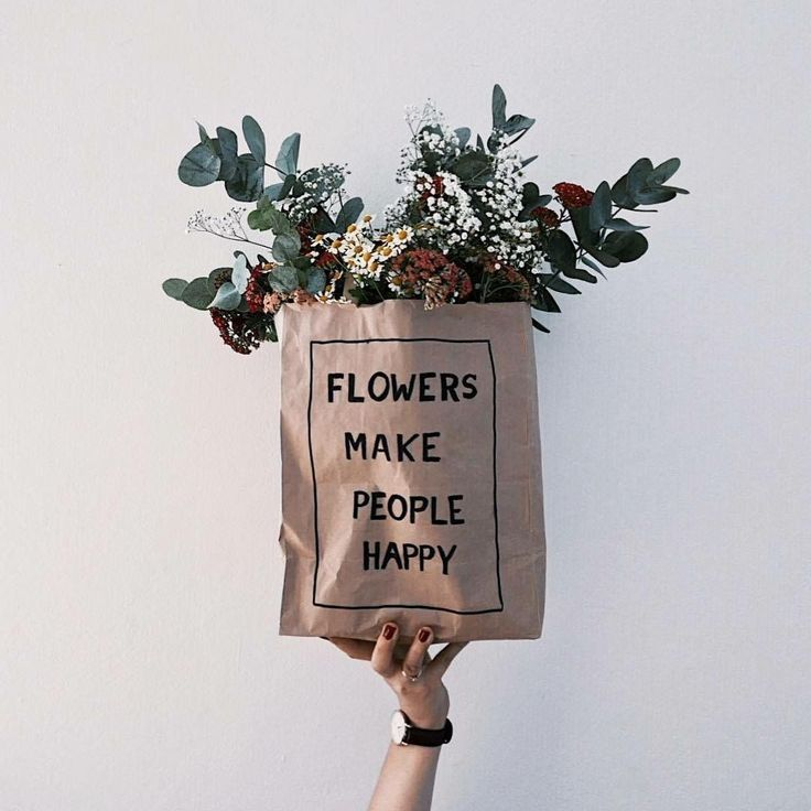 """Florals in a paper bag. """"Flowers make people happy""""."""